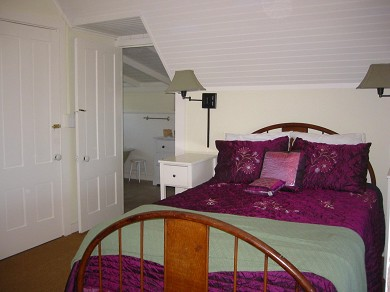 Oak Bluffs Martha's Vineyard vacation rental - Master bedroom with sunporch with harbor view