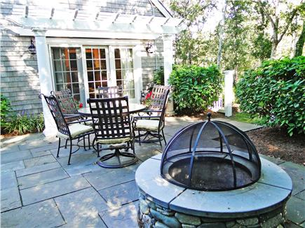 Edgartown Martha's Vineyard vacation rental - Relaxing patio w/ table, fire pit, flowering plants