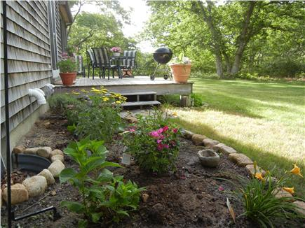 West Tisbury Martha's Vineyard vacation rental - Flower bed, back deck, partial view of back yard