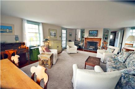 Edgartown Village Martha's Vineyard vacation rental - Living room with fireplace & French door out to the deck