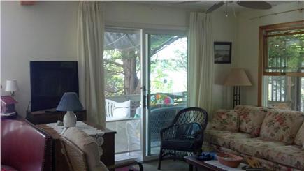 Oak Bluffs Martha's Vineyard vacation rental - Living room showing sliding door to deck and flat screen TV