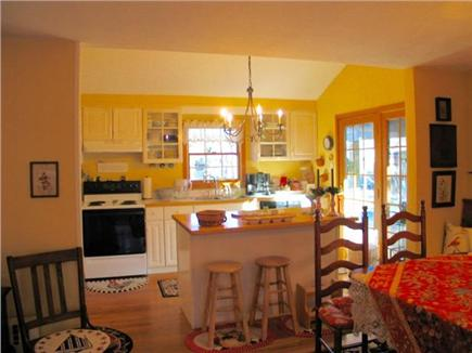 Edgartown Martha's Vineyard vacation rental - Kitchen atrium doors open to patio, pergola, grill and shed.