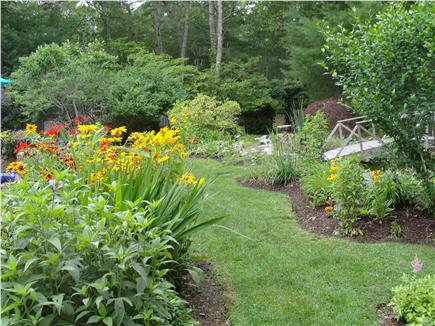 Vineyard Haven Martha's Vineyard vacation rental - View  of backyard flower beds leading to the pond