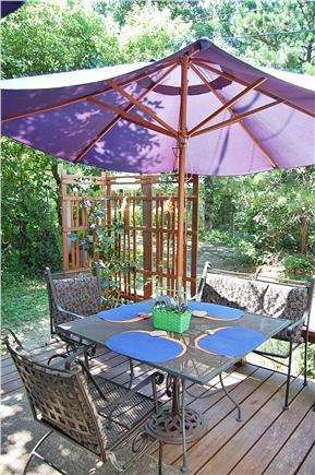 Oak Bluffs Martha's Vineyard vacation rental - Outdoor Room with corner view of dining table and plants/flowers