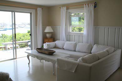 Oak Bluffs Martha's Vineyard vacation rental - Living room with deck outside & harbor view