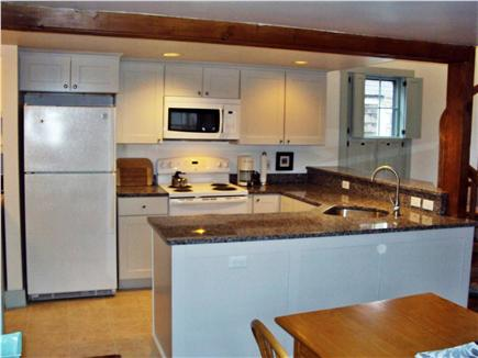 Nantucket town Nantucket vacation rental - New kitchen with granite counters.  Laundry area to left.