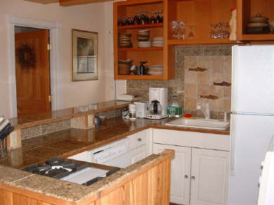 Siasconset Nantucket vacation rental - Complete kitchen with granite countertops, Viking® range & hood.