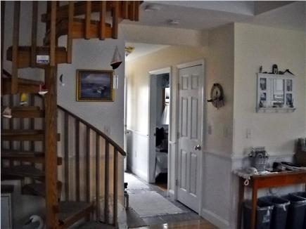 Nantucket town Nantucket vacation rental - Hall to back deck & yard.  Custom made circular staircase on left